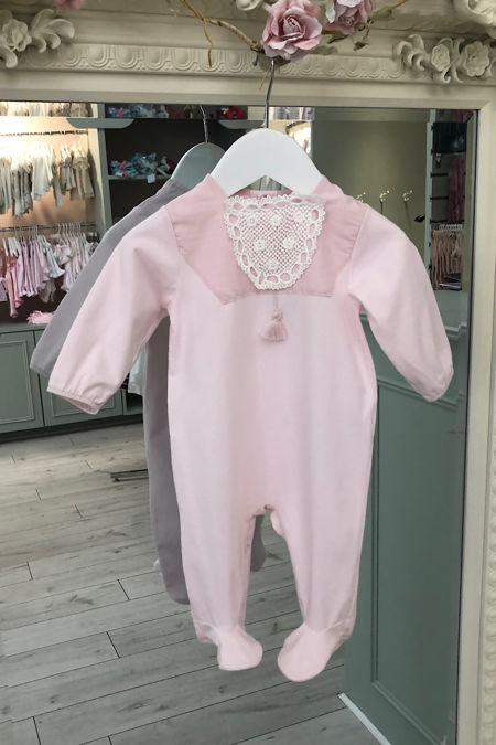 Penelope pink babygrow with white crochet detail