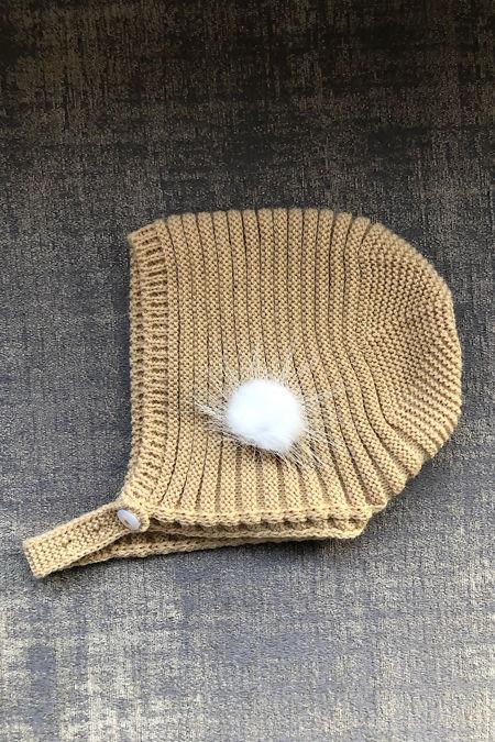 beige knitted pom pom bonnet